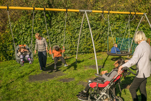 children from SEN school in Yorkshire playing on HAGS inclusive swing